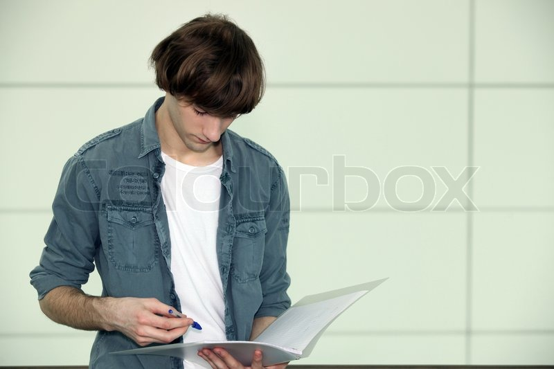 Stock image of 'Teenager studying'
