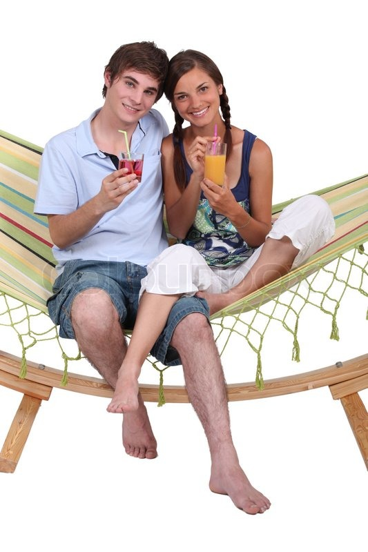 Stock image of 'Couple sitting in a hammock'
