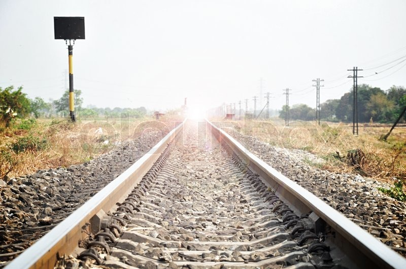 Stock image of 'Railway track with flash light at the end'