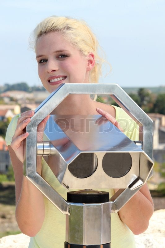 Stock image of 'Blonde woman with telescope'