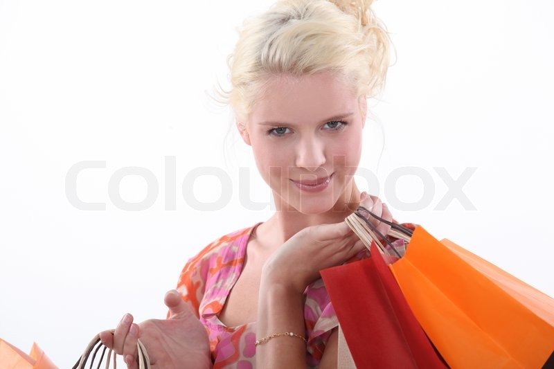 Stock image of 'Woman carrying shopping bags'