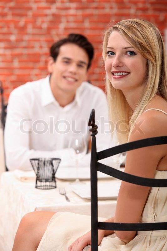 Stock image of 'Man and woman dining at a restaurant'