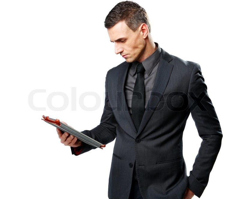 Stock image of 'Businessman using tablet computer isolated on a white background'
