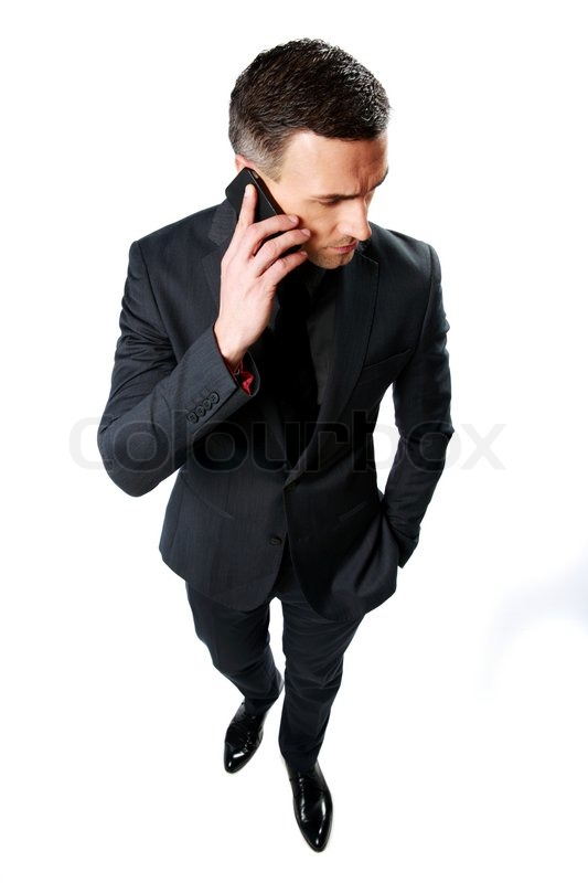 Stock image of 'Portrait of a businessman speaking on cell phone isolated on a white background'