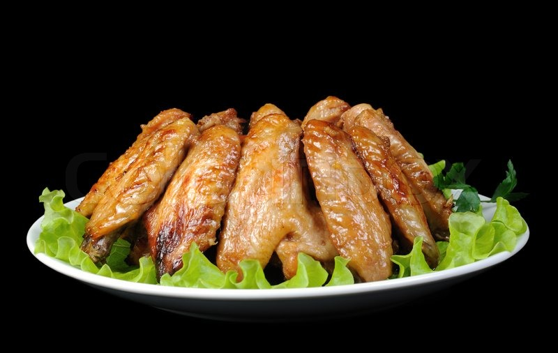 Stock image of 'Baked chicken wings in honey and soy marinade'