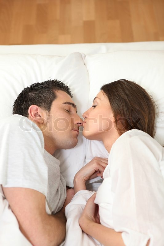 Stock image of 'Couple in bed'