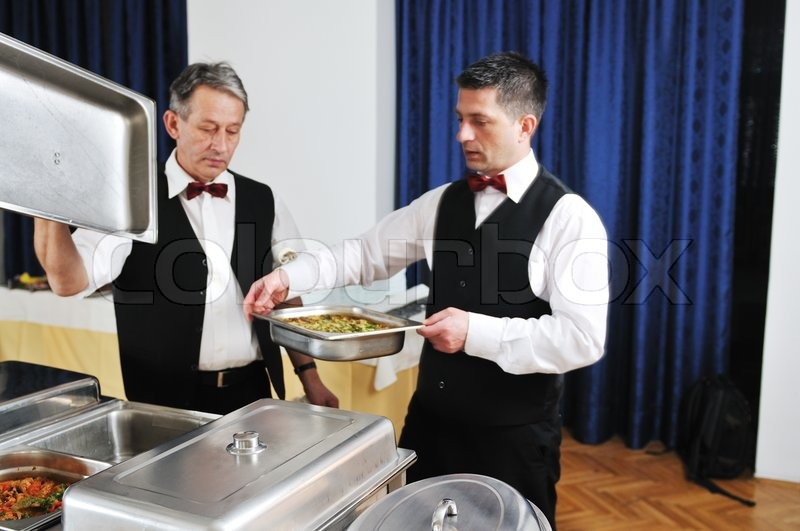 Stock image of 'catering buffet food party preparation man'