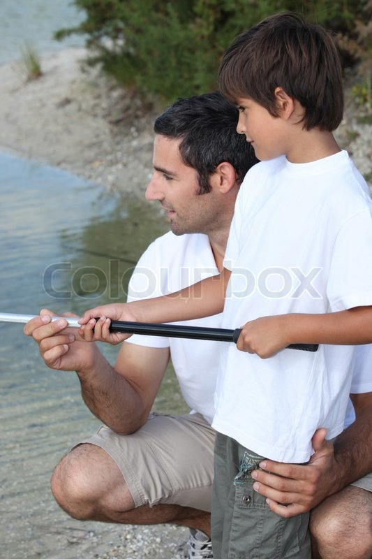 Stock image of 'Father and son fishing'