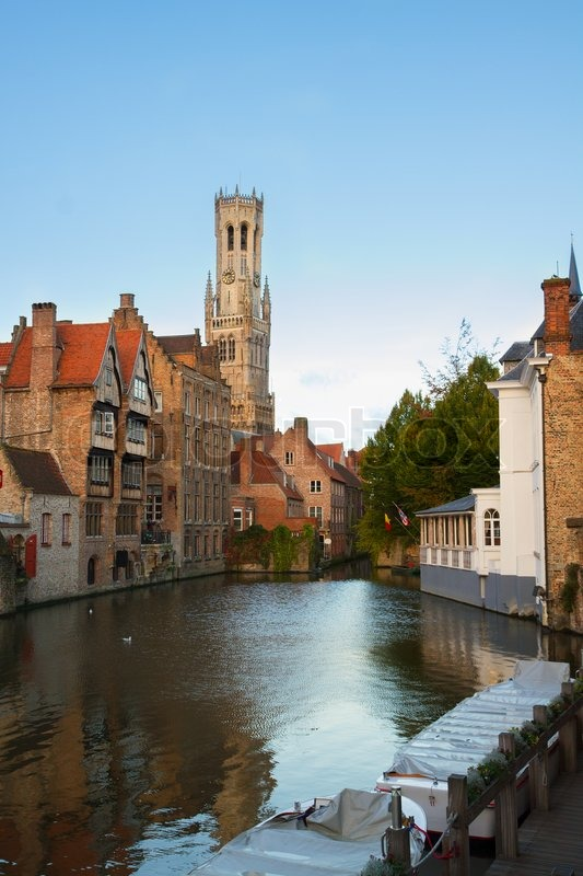 Stock image of 'classical view of old Bruges with Belfort tower and canal water, Belgium'