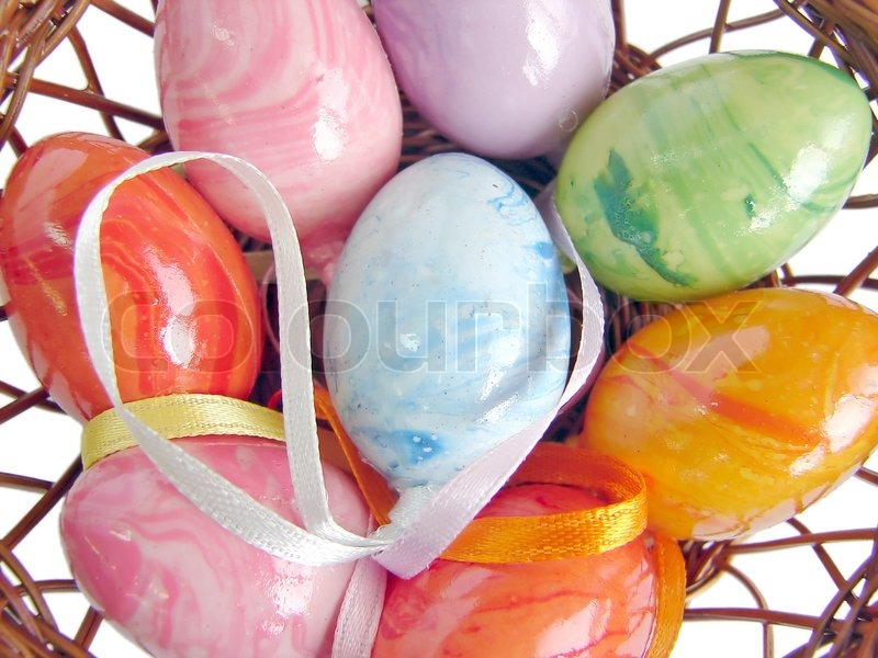 Stock image of 'Easter eggs in basket'