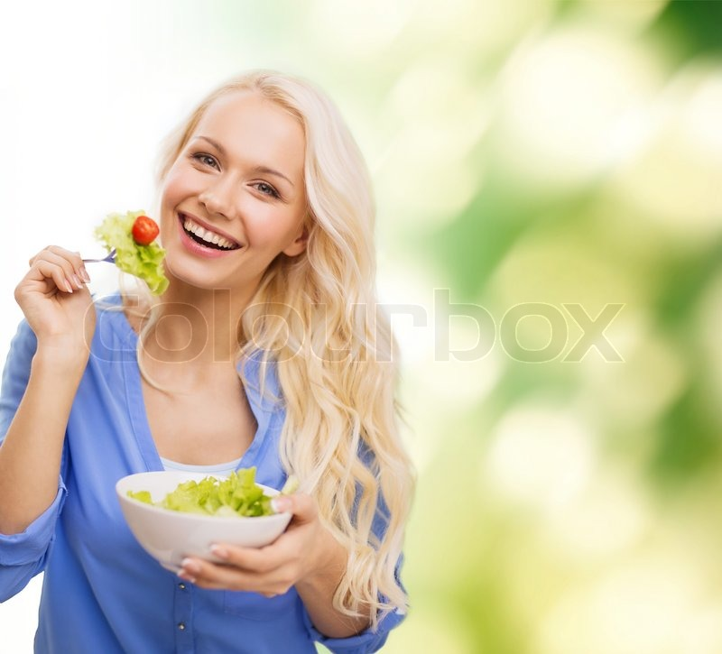 Stock image of 'healt, dieting and happiness concept - smiling young woman with green salad'