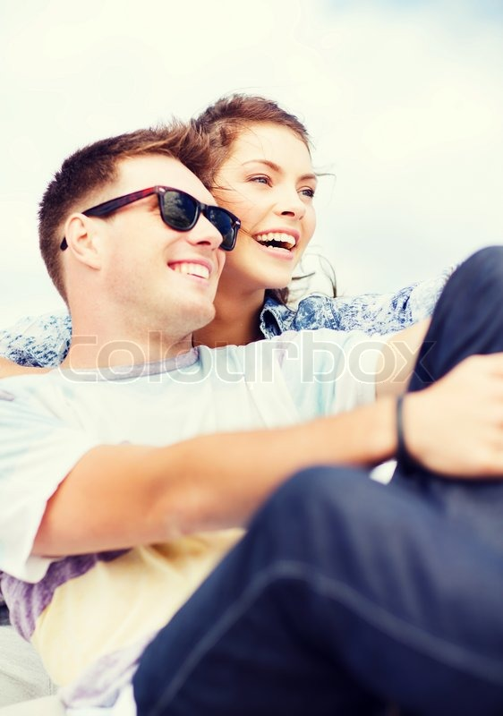 Stock image of 'summer holidays and teenage concept - teenagers hanging out outside'
