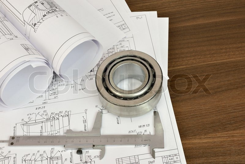 Stock image of 'Construction drawings, caliper and bearing. Desk Engineer'