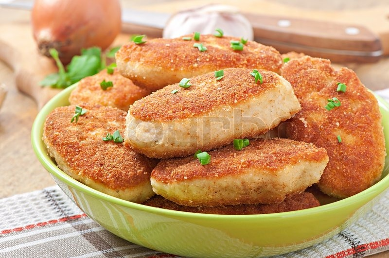 Stock image of 'Chicken cutlets in  bowl'