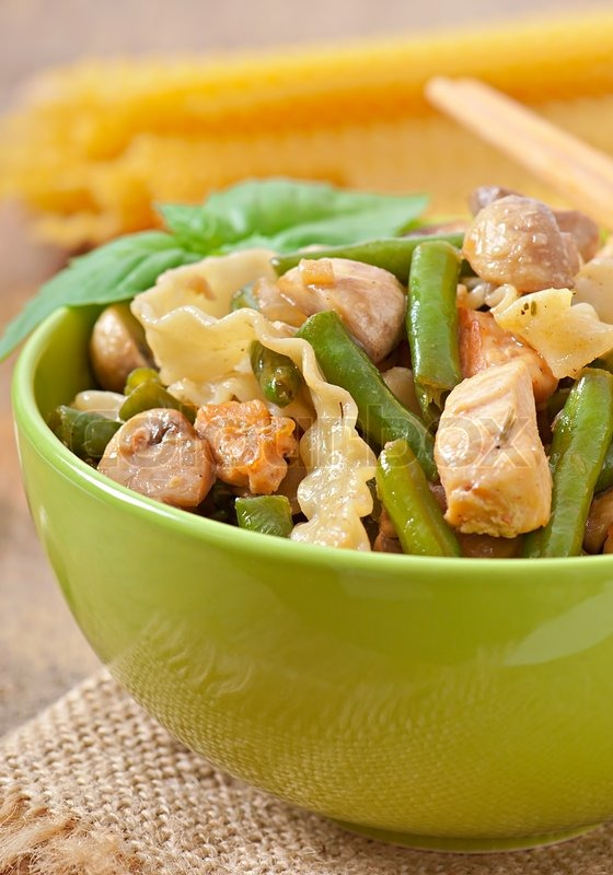 Stock image of 'Noodles with meat, beans and mushrooms'