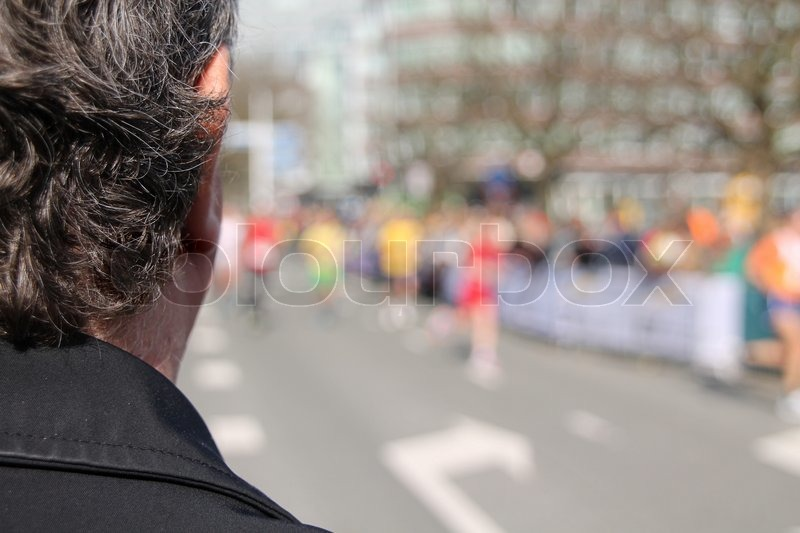 Stock image of 'The man, he is watching to the marathon.'