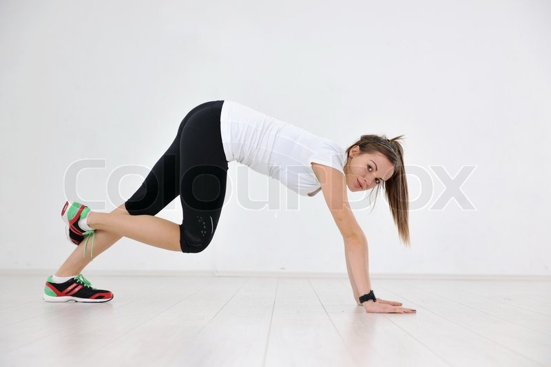Stock image of 'beaudiful young woman fitness workout with weights at sport club'