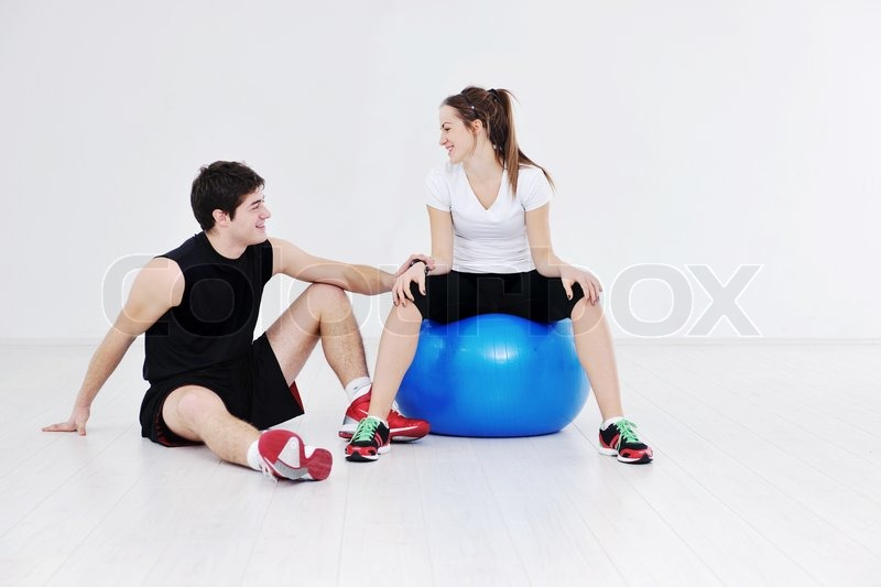Stock image of 'happy young couple fitness workout and fun at sport gym club'