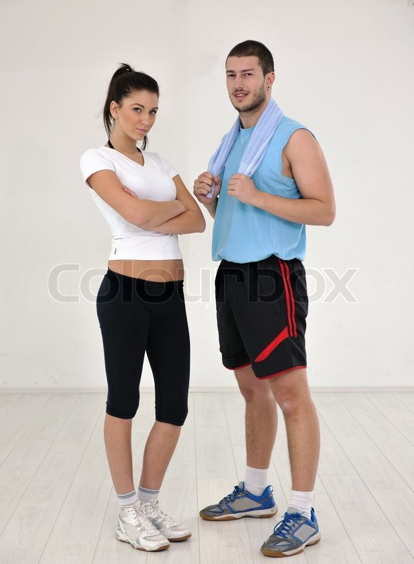 Stock image of 'happy young people group in excercise and relax in  fitness club'