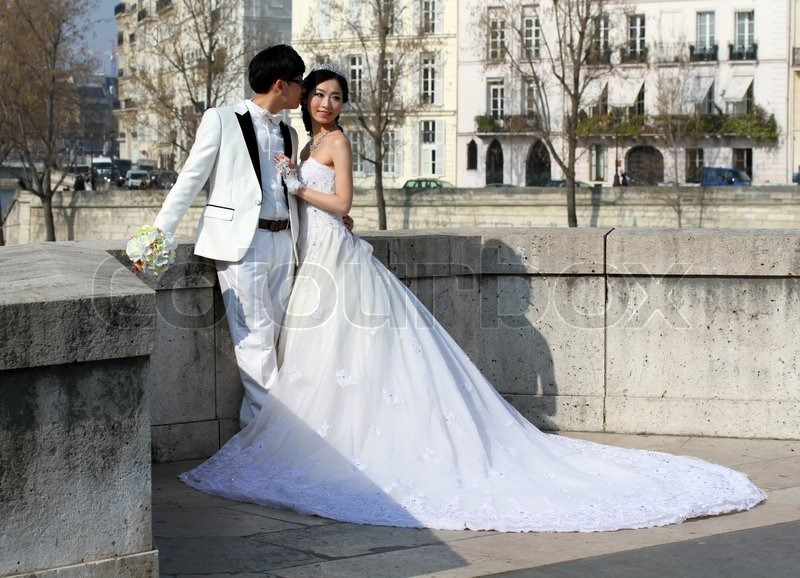 Editorial image of 'Asian newly wedding couple posing for pre wedding photography on the Tournelle  Bridge in Pars'