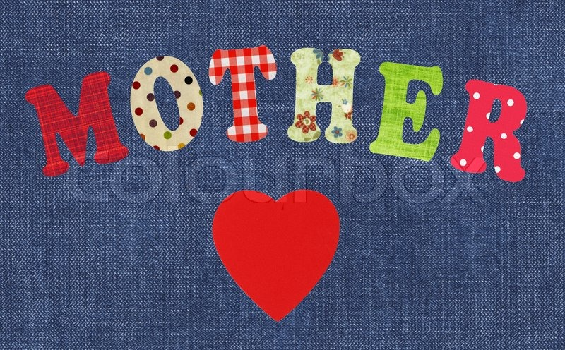 Stock image of 'Mother- lettering of handmade paper letters and red heart over jeans'