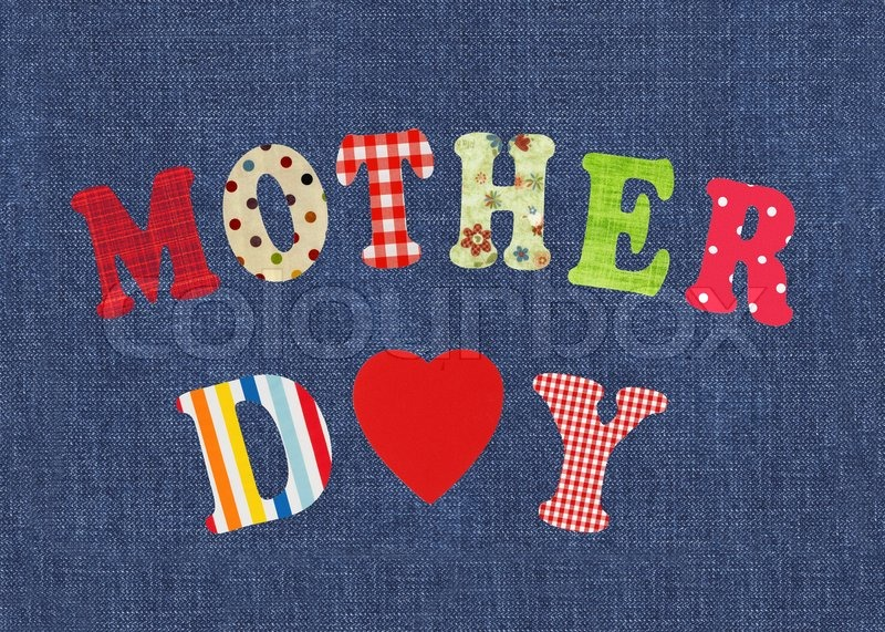 Stock image of 'Mother- lettering of handmade paper letters over jeans background'
