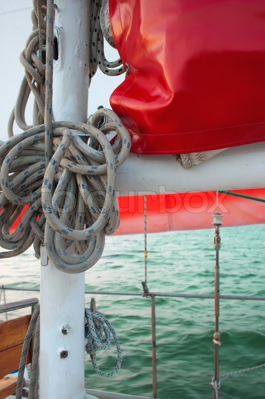 Stock image of 'Ropes on classic sailboat - tackles on the yacht.'