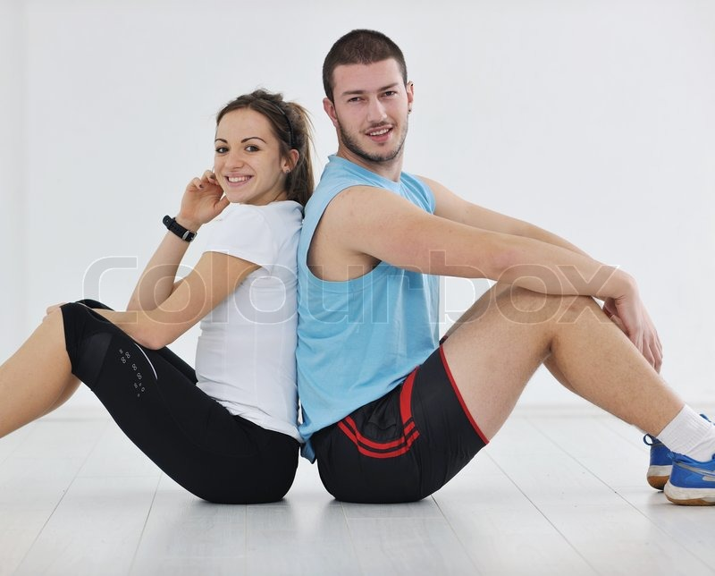 Stock image of 'happy young couple fitness workout and fun at sport gym club '