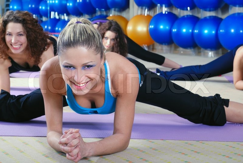 Stock image of 'young girls group working out in fitness club'