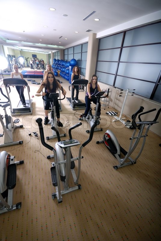 Stock image of 'group of girls working out on treadmill at  fitness gym'