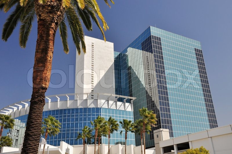Stock image of 'Palm trees mix with glass and steel towers in downtown Riverside, California.'