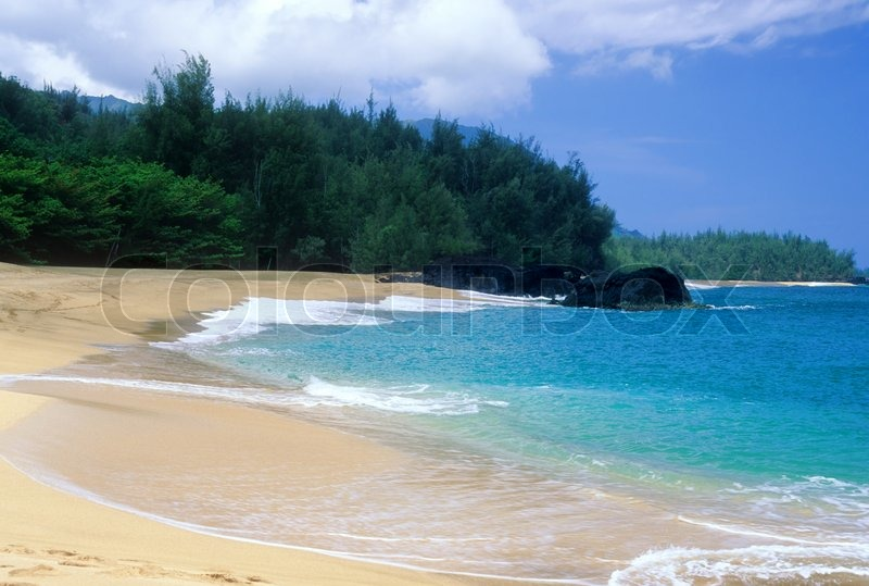 Stock image of 'Beautiful Lumahai Beach is a secluded paradise found on the north shore of Kauai, Hawaii.'