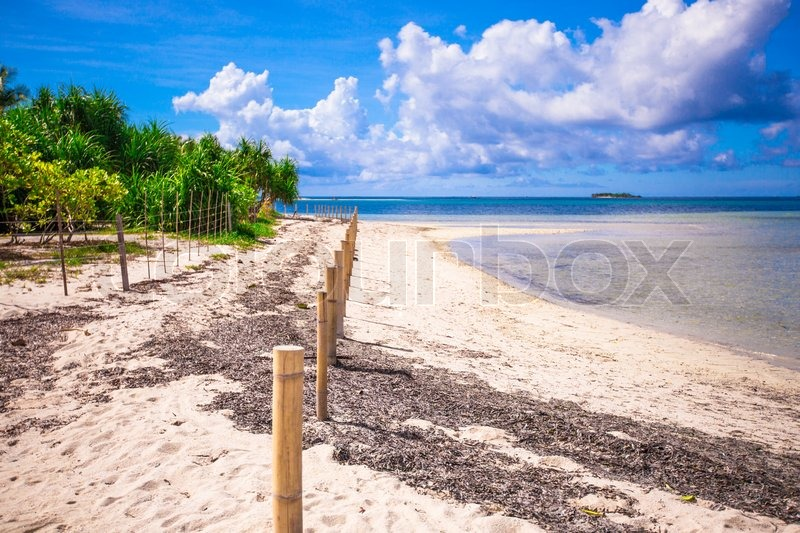 Stock image of 'Ideal tropical beach with turquoise water and white sand on a desert island'