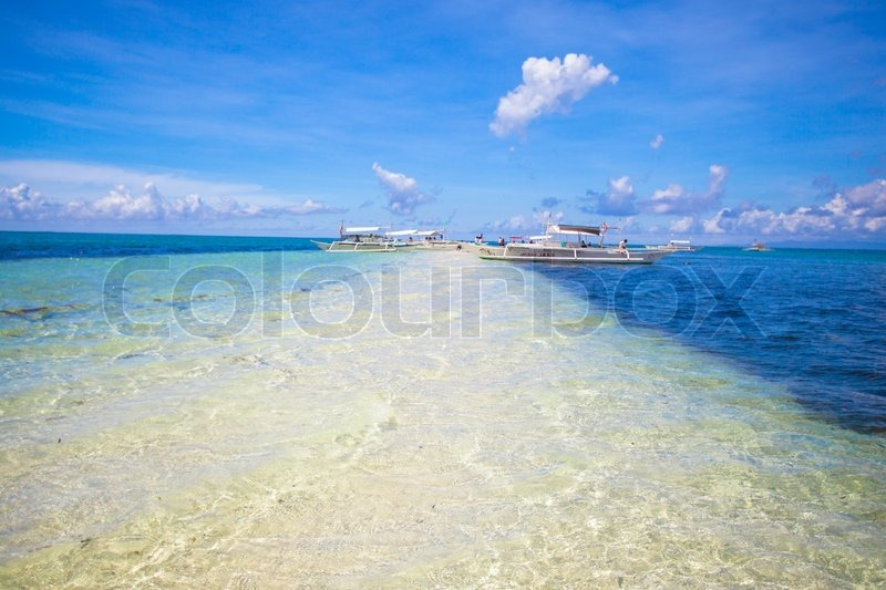 Stock image of 'Small boats on the white tropical beach'