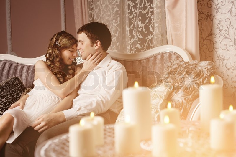 Stock image of 'Happy Couple in love hugs at home'