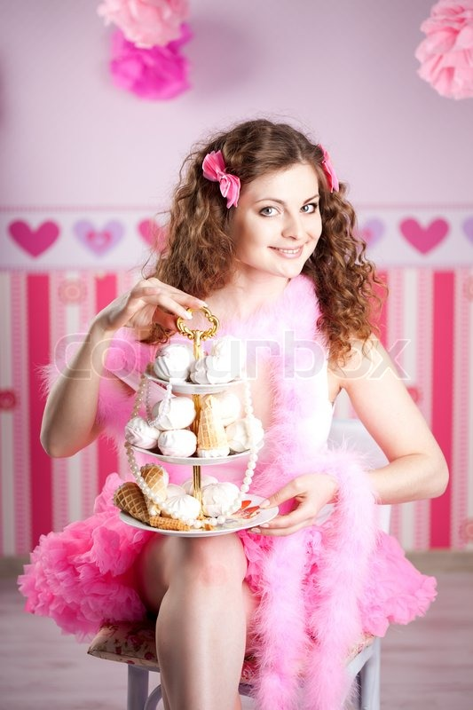Stock image of 'Sexy sweet young woman in pink room'