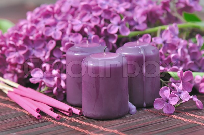 Stock image of 'decorated with flowers of lilac purple, candles and encense  to unwind'