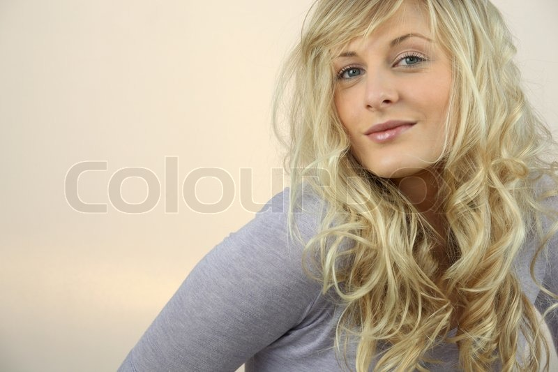 Stock image of 'Beautiful young woman with curly blond hair'
