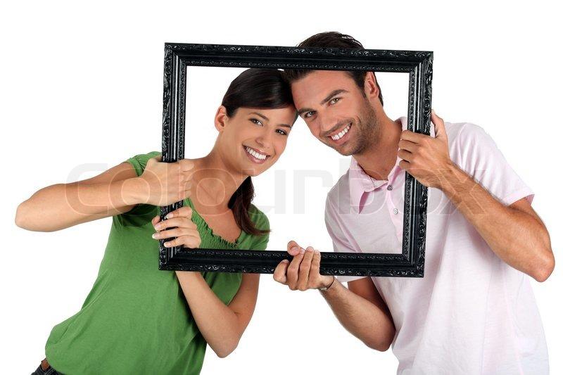 фотобанк держит раму сайте собраны