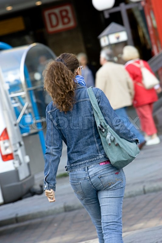 A sexy woman in jeans crossing the ...  60ab3c39e4b