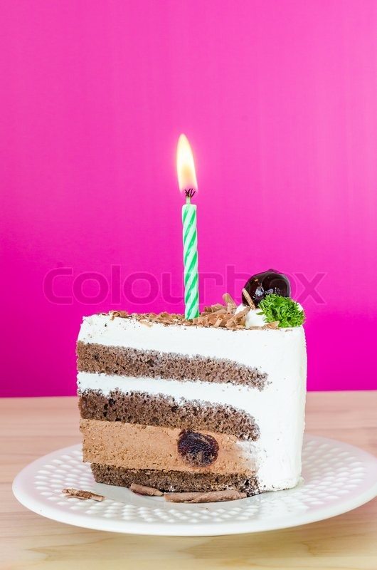 Chocolate cake with black cherry in white dish&colorful background, stock photo