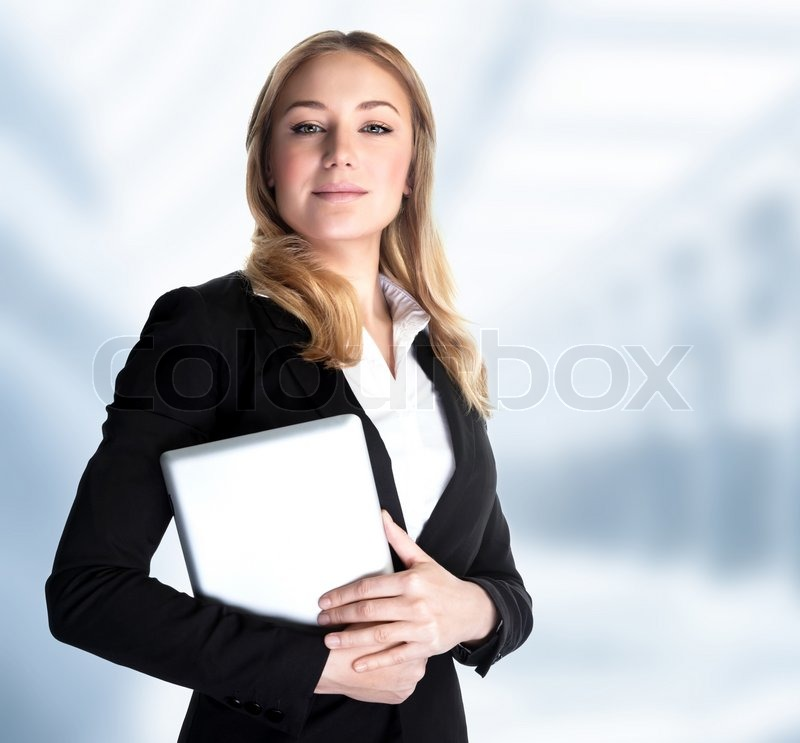 Smart Business Woman Holding In Hands Laptop And Standing