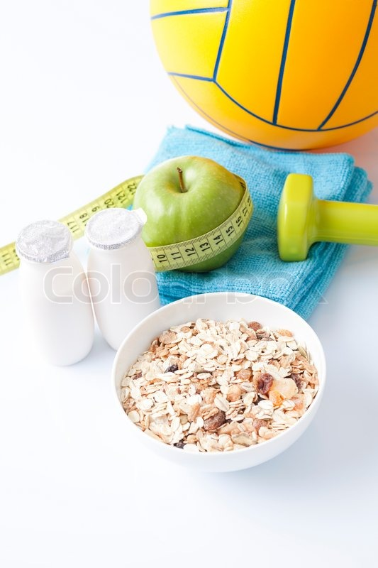 Healthy food and sport equipment isolated on white, stock photo