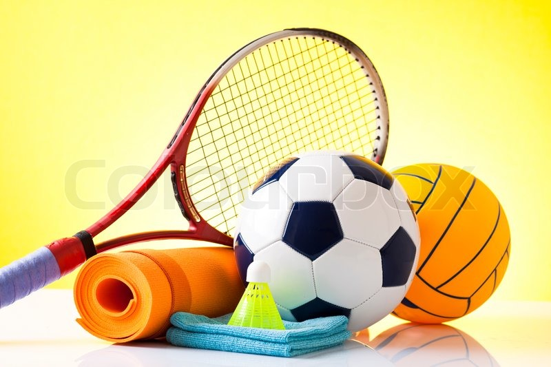 Assorted sports equipment including a basketball, soccer ball, tennis ball, baseball,, stock photo