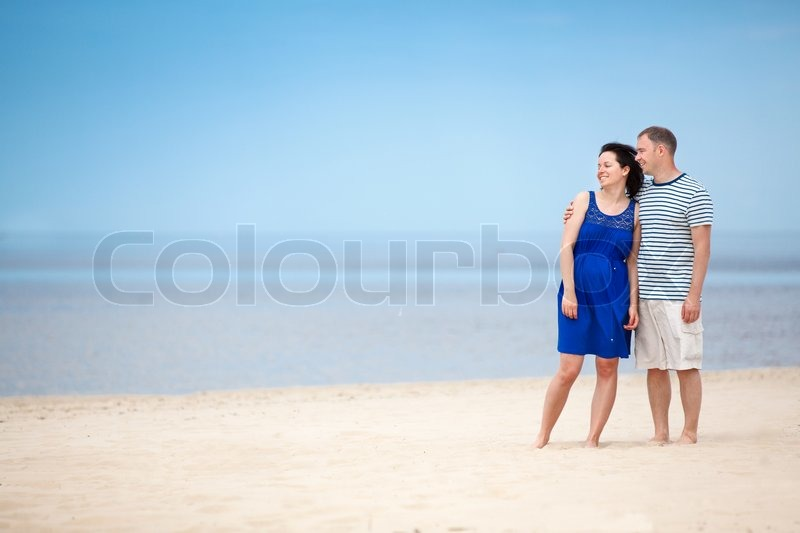 Young couple at tropical beach during summer vacation for Tropical vacations for couples