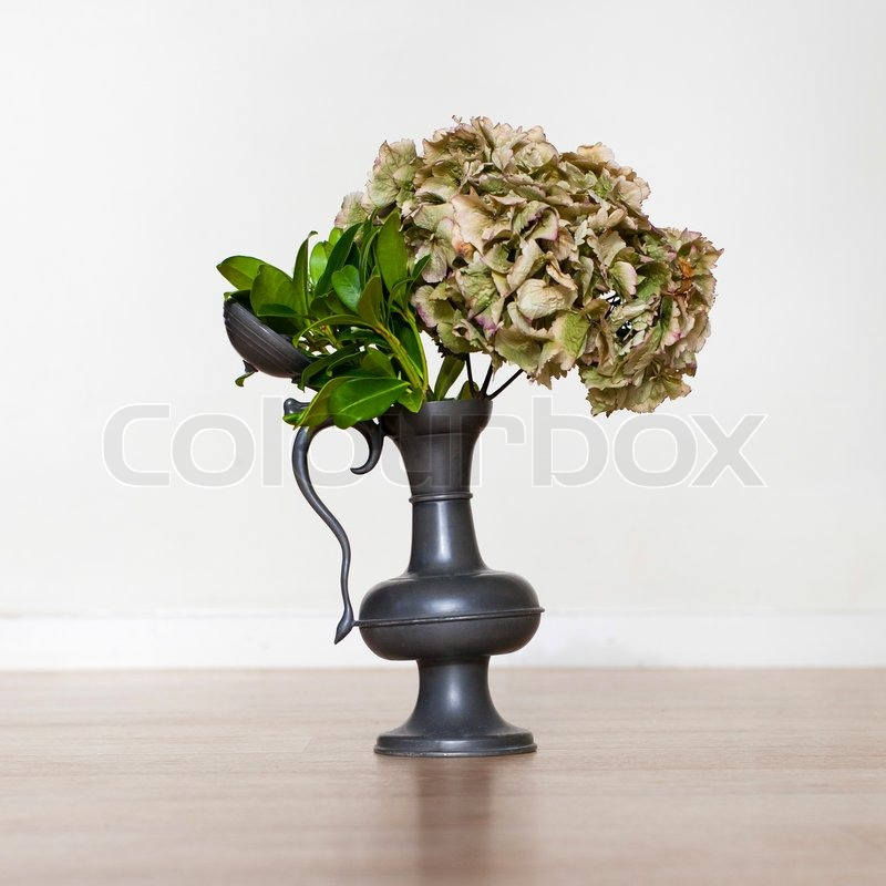 Flowers In An Old Tin Vase On A Wooden Table Stock Photo Colourbox