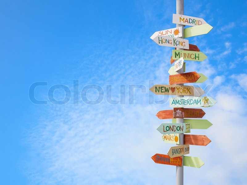 Travel traffic sign and blue sky, stock photo