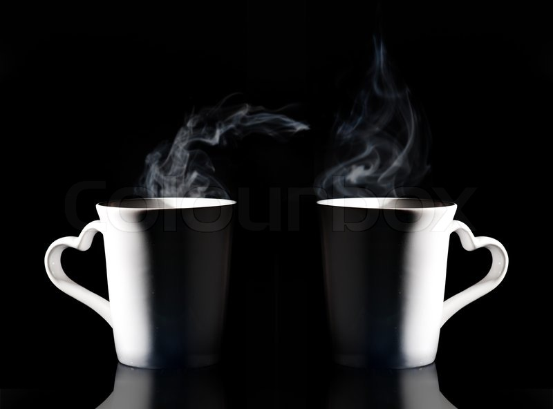Coffee cup with smoke isolated black background, stock photo