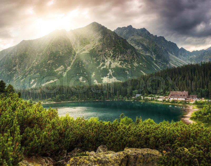 Mountain landscape with mountain chalet near Poprad Pond, High Tatras, Slovakia, stock photo