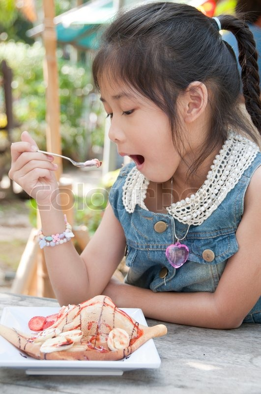 Little Asian Girl Eating Strawberry Crape Ice Cream Stock Photo Colourbox